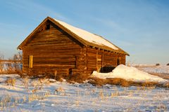 Abandoned old log barn in winter Stock Image