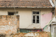 Abandoned old red brick house with windows Stock Image