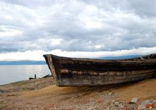 Abandoned old rotten boat. The abandoned old rotten boat placing on the coast of lake Stock Images