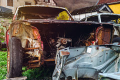 Abandoned old rusty body and parts of retro car Royalty Free Stock Images