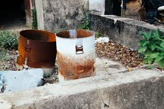 Abandoned old rusty drum barrels at Lamma island old town village in Hong Kong Stock Photo