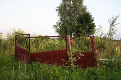 Abandoned old rusty gate on wasteland Stock Image