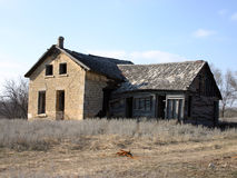Abandoned Old Stone Farm House. With rotting roof Stock Image