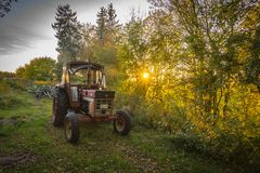 Abandoned old tractor sunset shot Stock Photo