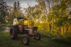 Abandoned old tractor sunset shot Royalty Free Stock Photos