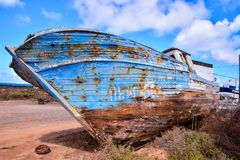 Wooden boat on beach. Abandoned old vintage Wooden fishing boat on beach Royalty Free Stock Photo