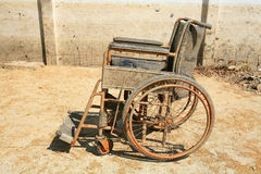 Abandoned old wheelchair Stock Images