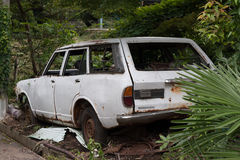 Abandoned old white car Royalty Free Stock Photography
