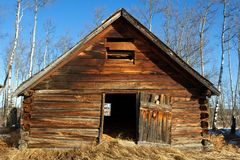 Abandoned old wooden barn in late winter Royalty Free Stock Images