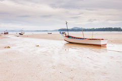 Abandoned old  wooden boat on the beach in Phuket, Thaialnd Stock Photography