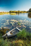 Abandoned Old Wooden Fishing Boat In Summer Lake Or River. Beautiful Summer Sunny Day Royalty Free Stock Photos