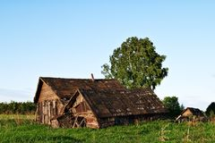 Abandoned old wooden houses in rural area Stock Photos