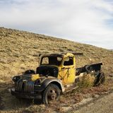 Abandoned old yellow pickup Stock Images