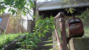 Abandoned Overgrown Home Establishing Shot stock video