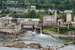 Abandoned paper mill factory on Willamette river royalty free stock images