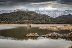 Abandoned and partially submerged stone building in lake in Cors Royalty Free Stock Photo