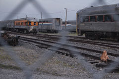 Abandoned Passenger Trains. Abandoned Passenger Traincars in railyard Stock Images