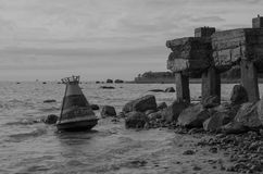 Abandoned pier. Buoy on the shore of abandoned concrete pier Royalty Free Stock Photography