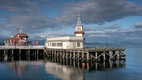 Abandoned Pier and victorian church in the sea at a harbour in Dunoon on the West coast of Scotland UK stock video