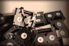 Abandoned pile of old useless mini DV. (video cassette tape or betamax) in old vintage colour style royalty free stock photo