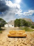 Abandoned place and sofa Stock Images