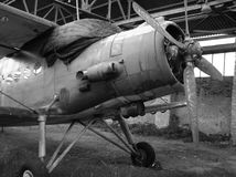 Abandoned plane. Abandoned old plane in ruined hangar stock image