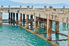 Abandoned port in the sea, unfinished construction stock image