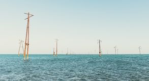 Abandoned power lines. In sea Stock Photography