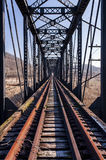Abandoned Pratt Through Truss Railroad Bridge - Track View. A view of an abandoned railroad Pratt through truss bridge in southern Ohio on a sunny winter stock photography