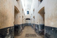 Abandoned Prison in Salvation& x27;s Islands, French Guiana. Isolation cells inside a penal colony at Ile Royale, one of the islands of Iles du Salut & x28 Royalty Free Stock Images