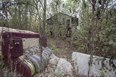 Abandoned property in decay dumping. Site in rural Arkansas usa wood house falling down stock image