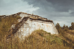 Abandoned protective bunker. KRASNAYA GORKA, RUSSIA - AUGUST 23, 2014: Abandoned protective bunker on the military-historical site of Fort Krasnaya Gorka, Russia Stock Image