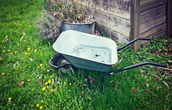 Abandoned pushcart on green field Stock Photography