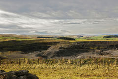 Abandoned Quarry. A abandoned quarry in weardale looking west with darkening clouds moving in Stock Image