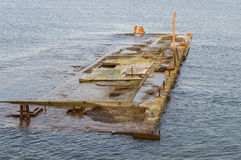 Abandoned quay submerged in water Royalty Free Stock Images