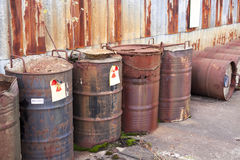 Abandoned radioactive waste. Radioactive waste stored in barrels Stock Photos