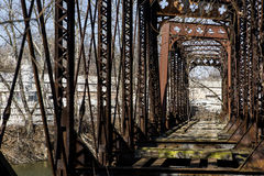 Abandoned Railroad Bridge - Pennsylvania. A view of an abandoned Pratt through truss bridge for the Pennsylvania Railroad over the Shenango River in New Castle royalty free stock photo
