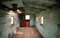 Abandoned Railroad Caboose Interior Western Ghost Town. The view inside an abandoned railroad caboose car stock image