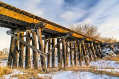 Abandoned railroad timber trestle. St Vrain Creek near Platteville, Colorado stock image