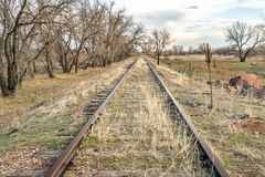 Abandoned railroad tracks in Colorado prairie. Abandoned  railroad tracks in a prairie of eastern Colorado royalty free stock photos