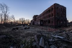 Abandoned Railroad YMCA at Sunset - Canton, Ohio. A long abandoned Pennsylvania Railroad YMCA as viewed at sunset in Canton, Ohio stock image