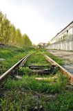 Abandoned rails. In old industrial district Royalty Free Stock Photo