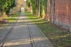 Abandoned rails, tram. In a lost part of ghent Stock Photo