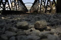 Abandoned railway bridge on a sunny day. Close up photo of the ground of an abandoned railway bridge on a sunny day Royalty Free Stock Photos