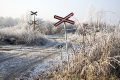 Abandoned railway track in freezing weather, rail crossing, sunny freezing weather, little dusting of snow Royalty Free Stock Photos