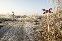 Abandoned railway track in freezing weather, rail crossing, sunny freezing weather, little dusting of snow Royalty Free Stock Image