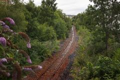 An abandoned railway track in Scotland under the rain royalty free stock photos