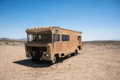Abandoned Recreational vehicle(RV) in the desert Royalty Free Stock Images