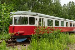 Free Abandoned Red And White Rail Bus Standing On An Overgrown Track Royalty Free Stock Photo - 164893745