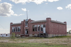 Abandoned red brick school. With broken windows Stock Photography